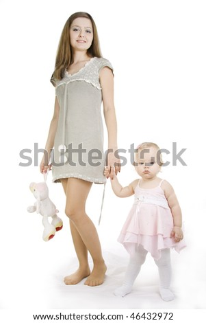 Young and beautiful mother with her sweet little daughter isolated on white. - stock photo