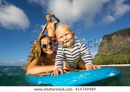 ride transparent young beautiful parents ride by surfboard stock photo 354044204