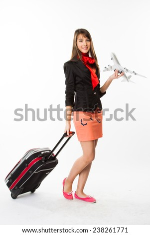 young and beautiful stewardess with model airplane - stock photo
