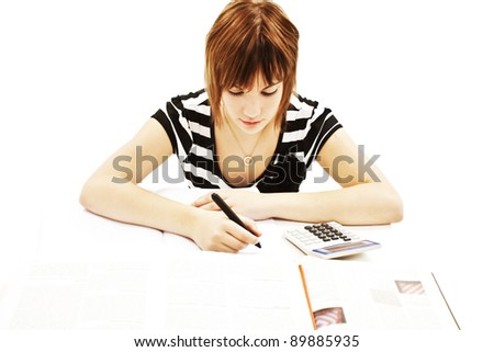 Young and beautiful student girl at the desk. Isolated on white background - stock photo