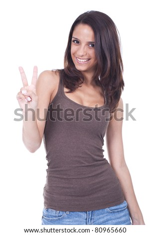 young and beautiful teenage girl doing victory sign - stock photo