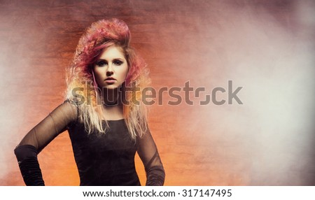 Young and beautiful witch. Halloween composition. - stock photo