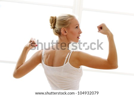 Young and beautiful woman doing fitness exircises - stock photo