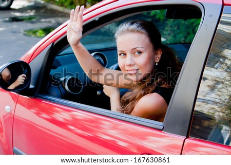 young and beautiful woman driving a car