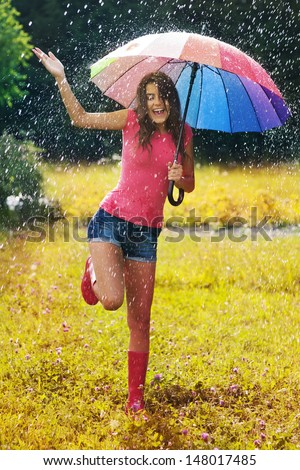 Young and beautiful woman have fun in rain  - stock photo