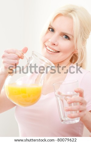 Young and beautiful woman having breakfast in the morning - stock photo
