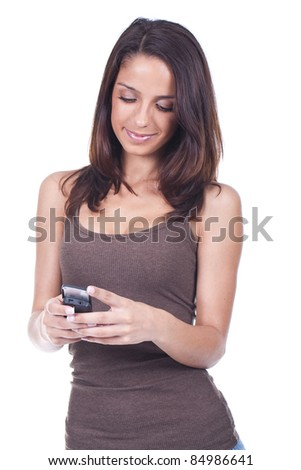 young and beautiful woman holding a cellphone and smiling - stock photo