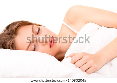 Young and beautiful woman in bed