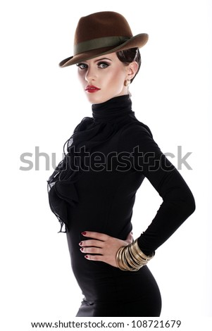 Young and beautiful woman in hat over white background - stock photo