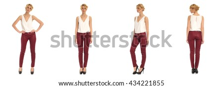 Young and beautiful woman in red leather pants isolated over white
