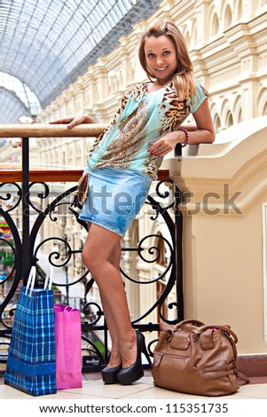 Young and beautiful woman in the mall with shopping - stock photo