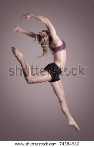 Young and beautiful woman jumping with hands in the air