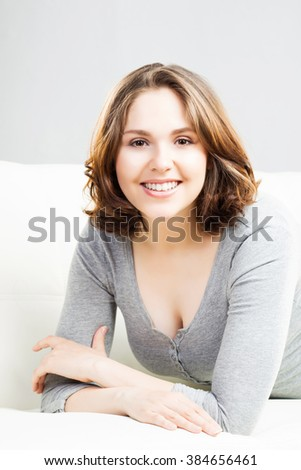 Young and beautiful woman on a sofa at home.