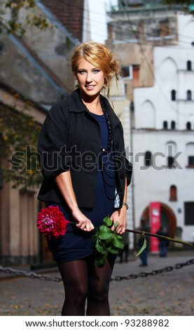 Young and beautiful woman on the old city street - stock photo