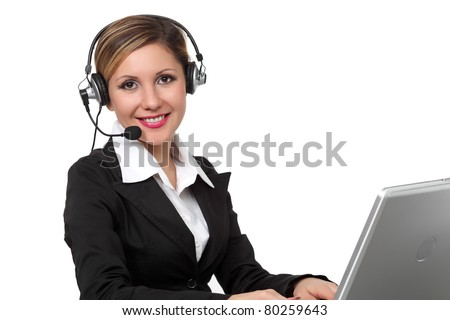 Young and beautiful woman  with headset working at  laptop on the white background - stock photo