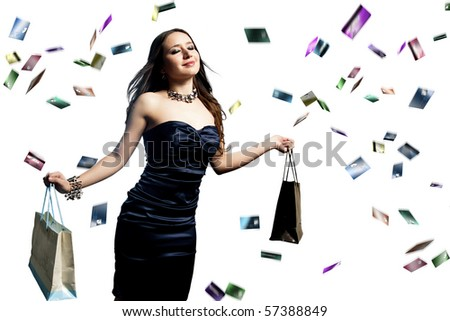 young and beautiful woman with shopping bags and raining credit cards