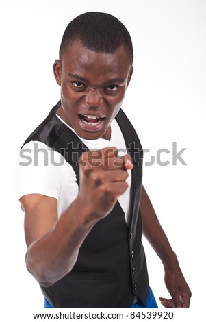 young and beautiful young man looking angry with his fist up - stock photo