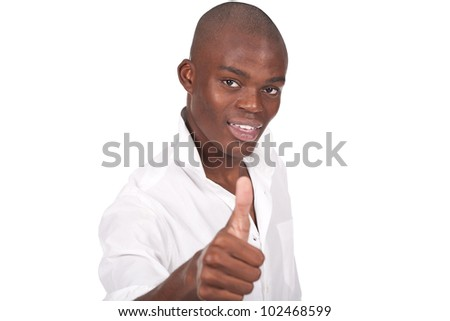 young and black man doing ok sign with thumb up (focus is on the face) - stock photo