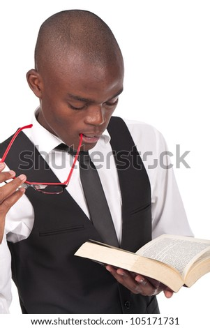 young and black man holding and reading a book - stock photo