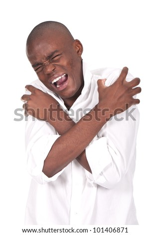 young and black man yelling and shouting with pain - stock photo