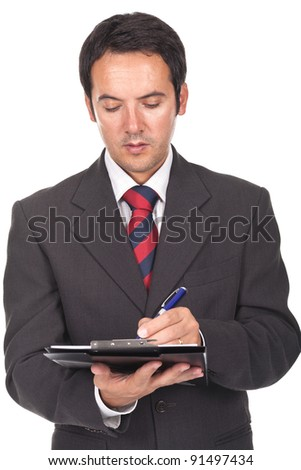 young and businessman writing some documents - stock photo