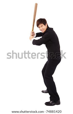 Young and confident  businessman holding  a baseball bat preparing to strike - stock photo