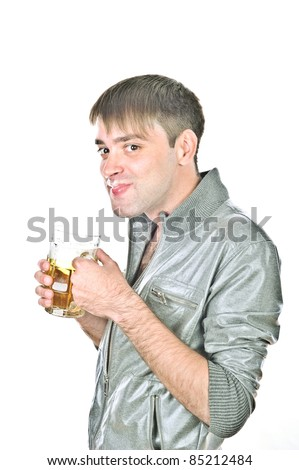 young and crazy guy is drinking beer from a large  mug, isolated over white
