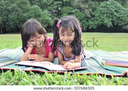 Young and cute best friends studying and do revision together. - stock photo