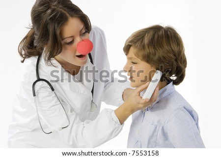 young and cute female doctor measuring temperature to a little boy