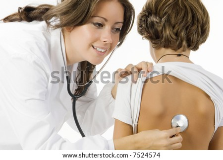 young and cute female doctor visiting with a stethoscope a little boy - stock photo