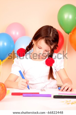 young and cute little girl painting a picture - stock photo
