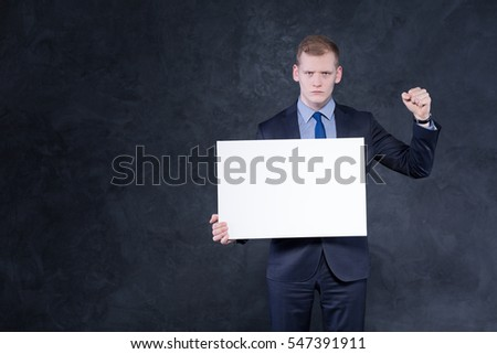 Young and determined young boy in a suit and a shirt
