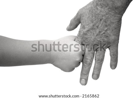 Young and elderly holding hands - stock photo
