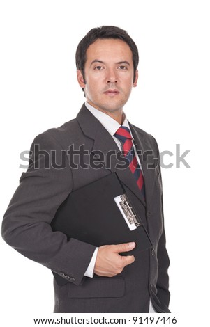 young and executive businessman holding a clipboard - stock photo