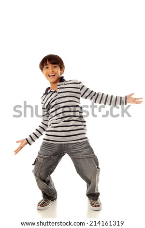 Young and fashion kid smiling with arms opened.  - stock photo