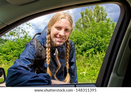 Young and friendly hitchhiker - stock photo