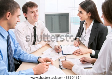 Young and good-looking business people are working in the meeting room.