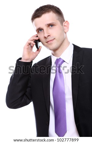 Young and handsome businessman using cellphone over white background