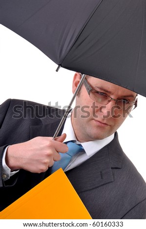 Young and handsome businessman with umbrella holding a yellow folder