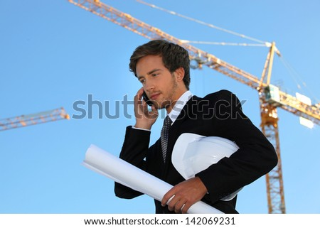 Young and handsome engineer working on-site - stock photo