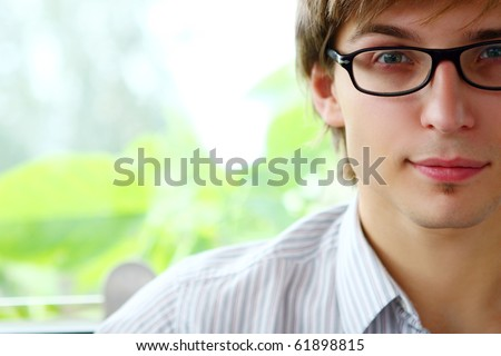 young and happy business man in offise - stock photo