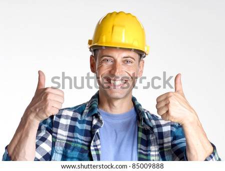 young and happy construction worker portrait.