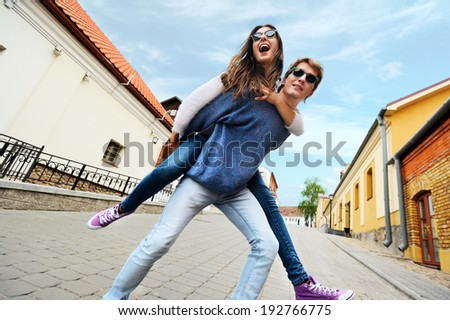 Young and happy couple in love having fun in the city - stock photo