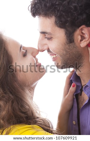 Young and happy couple over white background - stock photo