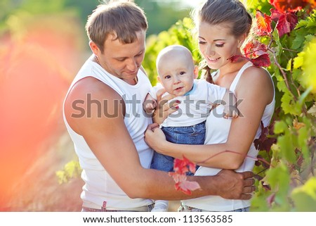 Young and happy family get stroll in the park