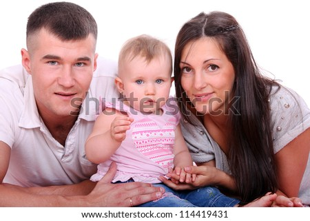 Young and happy family over white background - stock photo
