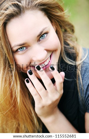 Young and happy girl relaxing in the park - stock photo