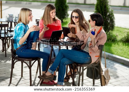 Young and happy girlfriends or classmates having fun at the School or University break. - stock photo
