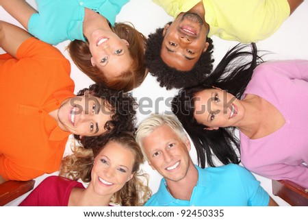 Young and happy people are lying down in a circle