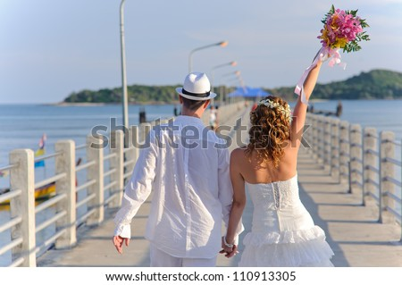 young and happy wedding couple. good use for loving concept - stock photo
